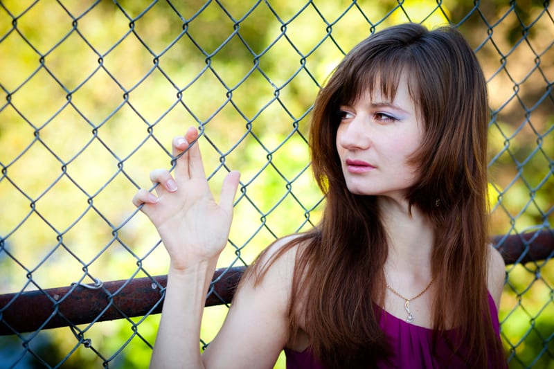 leaning-on-fence